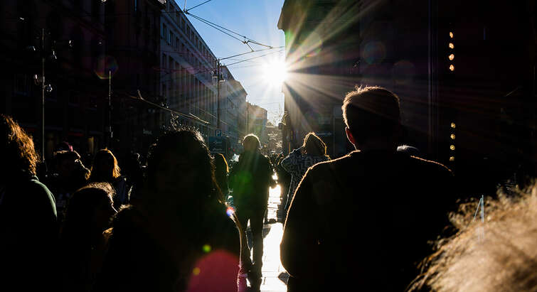 People walking against the sun